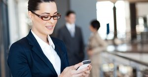 pretty businesswoman using smart phone